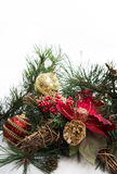 Christmas background with pine tree branch, pine cones, red flower in snow Royalty Free Stock Photography