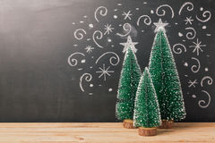 Christmas background with pine tree over chalkboard drawing Stock Photo
