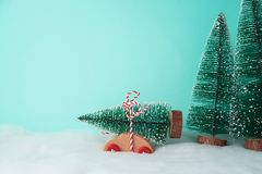 Christmas holiday background with pine tree on toy car. Christmas background with pine tree on toy car royalty free stock photography