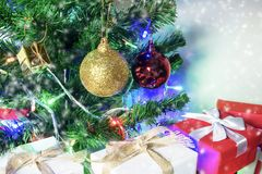 Christmas background with pine tree white and red gift box. Golden and red decor. Christmas background concept with copy space Stock Image