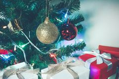Christmas background with pine tree white and red gift box. Golden and red decor. Christmas background concept with copy space Stock Photo