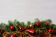 Christmas background with pinecone, golden and red ornaments Stock Images