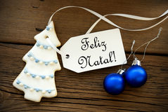 Christmas Background with Portuguese Christmas Greetings. Christmas Background with a Label on which the Portuguese Words Feliz Natal are written, which means Royalty Free Stock Image