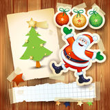 Christmas background with postcard and funny Santa Claus Stock Images