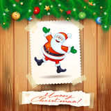 Christmas background with postcard and happy Santa Stock Photo