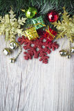Christmas background with present bosex and balls on wooden texture Royalty Free Stock Image