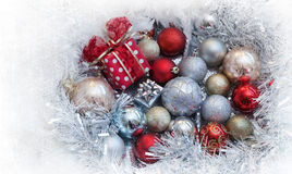 Christmas background with present box and balls Stock Image