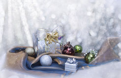 Christmas background with present box and balls Stock Photos