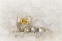 Christmas background with present box and balls Stock Images
