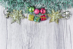 Christmas background with present boxes and balls on wooden texture Stock Photo