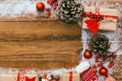 Christmas background - Christmas present  gifts box and decorating elements on wooden background. Royalty Free Stock Images