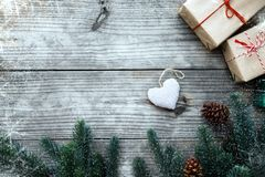 Ristmas present gifts box and rustic decoration on vintage wooden background Royalty Free Stock Photography
