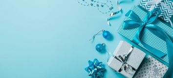 Christmas background - presents and decorations in silver and blue stock image