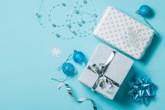 Christmas background - presents and decorations in silver and blue stock images