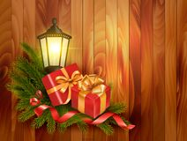 Christmas background with presents and a lantern. Stock Photos