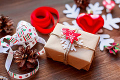 Christmas background with presents, ribbons, pinecones. Stock Image