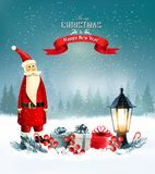 Christmas background with presents and Santa Claus. royalty free stock photos
