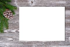 Christmas background of primed cardboard, twigs, cedar cones on Royalty Free Stock Photos