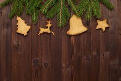 Christmas background of primed cardboard, twigs, cedar cones on. The Board Stock Photo