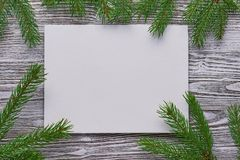 Christmas background of primed cardboard, twigs on the old Board. Christmas background of primed cardboard, twigs on the Board Royalty Free Stock Image