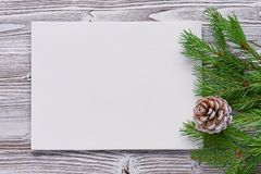Christmas background of primed cardboard, twigs, cedar cones on Royalty Free Stock Images