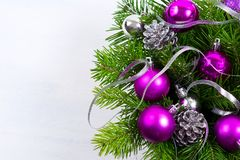 Christmas background with purple ornament, copy space. stock photos