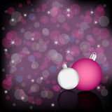 Christmas background. Purple Christmas background with two Christmas balls on bokeh background and stars Royalty Free Stock Image