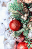 Christmas background with red ball, fir branches and Christmas tree Stock Images