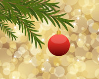 Christmas background. Red Christmas ball hanging from a tree on golden bokeh background Stock Image
