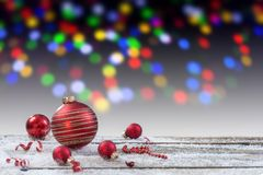 Christmas background with red christmas ball, on wooden board and Christmas multi-colored light,background royalty free stock photography