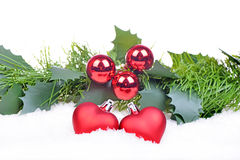 Christmas background with red balls, hearts Stock Photos
