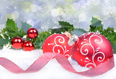 Christmas background with red balls and holly leaves Royalty Free Stock Photos