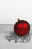 Christmas background- red bauble with silver chain Royalty Free Stock Photos
