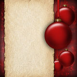 Christmas background - red baubles and blank paper sheet. For text Royalty Free Stock Photo