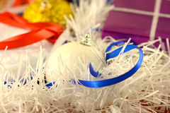 Christmas background with red and blue ribbon and white balls Royalty Free Stock Image
