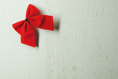 Christmas background, red bows. Shiny red satin ribbon on white background Royalty Free Stock Photography