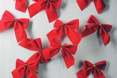 Christmas background, red bows. Shiny red satin ribbon on white background Stock Photo