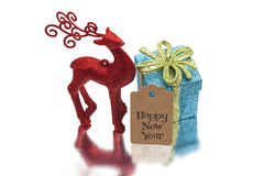 Christmas background with red deer, gift box and ornament Stock Photo