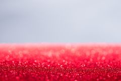 Christmas background red glittery unfocused with copy space. Background with red glitter and white stock image