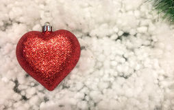 Christmas Background with Red and Green Concept, Shining Red Ornament Snowball in Heart Like Shape at The Corner Royalty Free Stock Photo