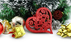 Christmas background with a red heart ornament Stock Image