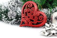 Christmas background with a red heart ornament. And decorations royalty free stock photo