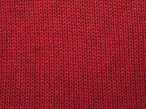 Christmas background from red knitted red wool Royalty Free Stock Photo