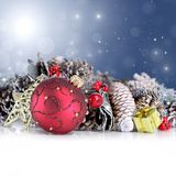 Christmas background with red ornament, garland an. D snowflakes falling from a blue sky royalty free stock photography