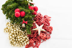 Christmas background with a red ornament, gift box, berries Royalty Free Stock Image
