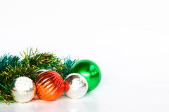 Christmas background with a red ornament, Green ornament and Silver ornament on white background. Stock Images