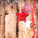 Christmas background with red ornaments and  falling snow over w Royalty Free Stock Image