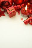 Christmas background. Red Christmas presents, baubles and candle on light background with copy space Stock Photo