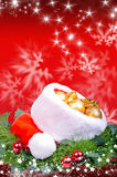 Christmas background with red Santa Claus hat Stock Photos