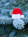 Christmas background and red Santa hat. Stock Photos